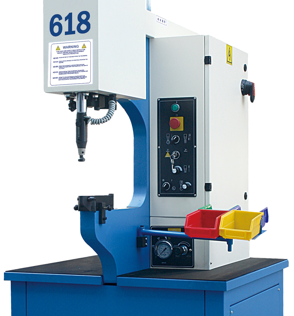 Machine for self clinhing fasteners